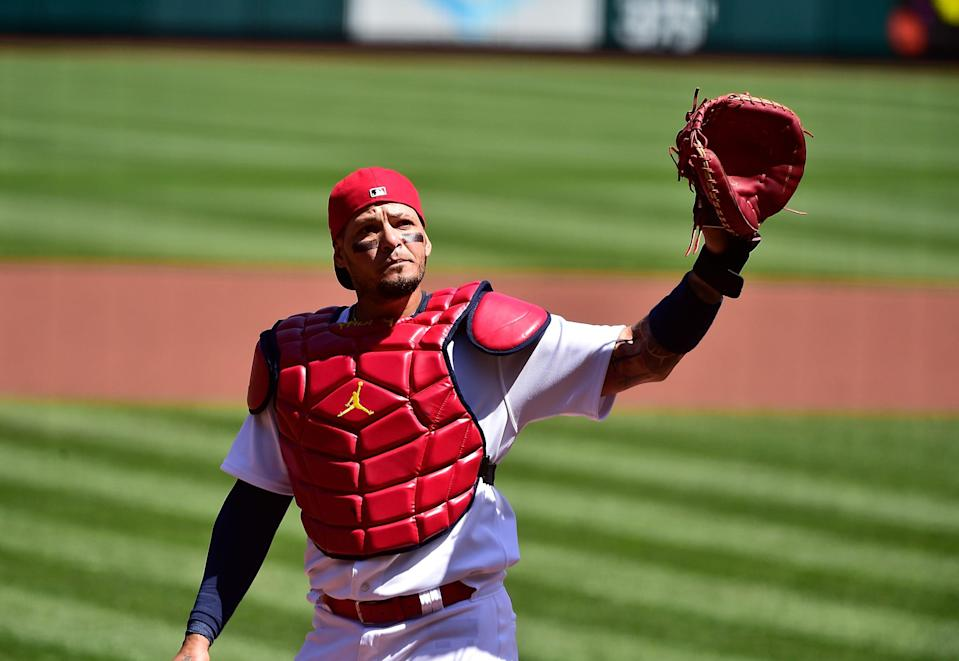 Cardinals' Yadier Molina salutes the fans as he receives a standing ovation for starting his 2,000 game as catcher for one organization.