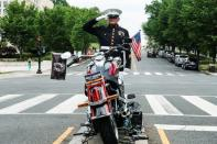 Marine SSGT Tim Chambers renders a salute paying respect for U.S. veterans on Memorial Day holiday in Washington