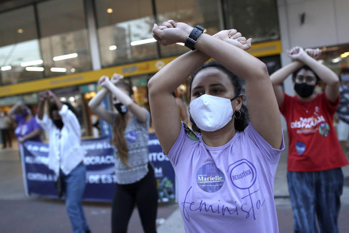 Image: Women wearing masks to curb the spread of the new coronavirus, participate in