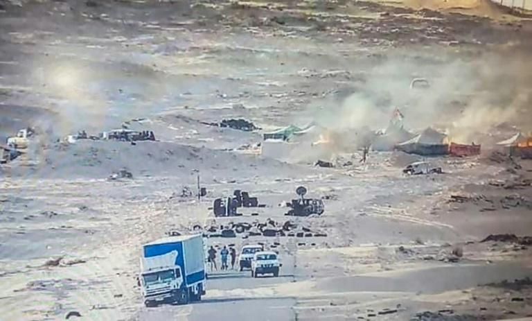 A handout picture published by the Royal Moroccan Army Facebook page on November 13, 2020, shows tents used by the Polisario Front ablaze near the Mauritanian border in Guerguerat after a military operation by Morocco