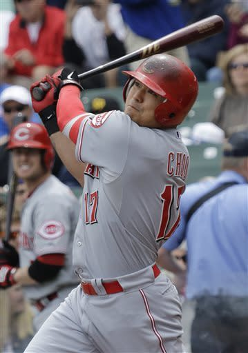 Cincinnati Reds' Shin-Soo Choo, of South Korea, hits a solo home run against the Chicago Cubs during the first inning of a baseball game in Chicago, Saturday, May 4, 2013. (AP Photo/Nam Y. Huh)