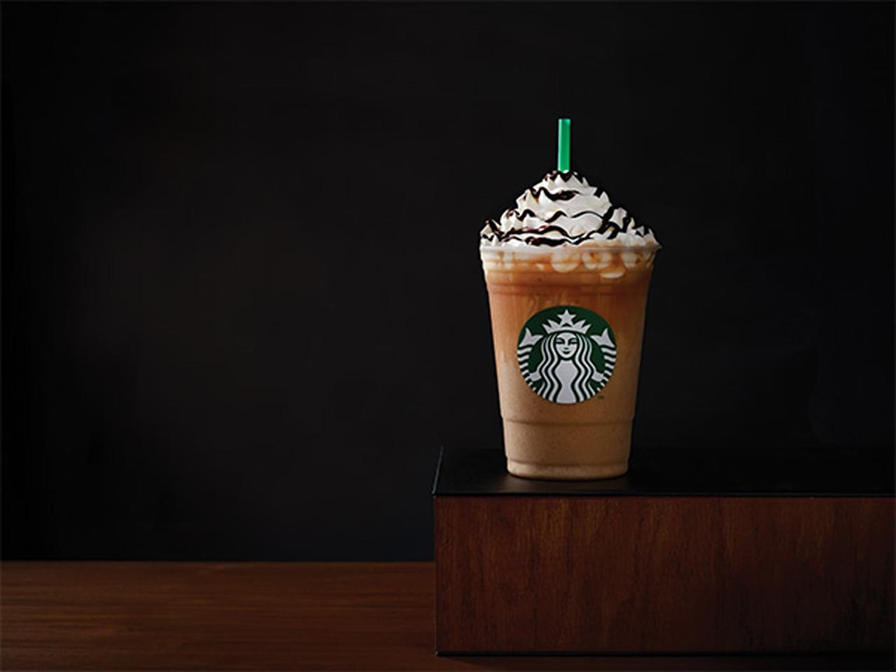<p><strong>What's in it:</strong> Coffee syrup is blended with milk and ice to form the base, then combined with mocha sauce and Frappuccino chips and topped with whipped cream and mocha syrup.<br> <strong>How much caffeine:</strong> 75 milligrams for a tall.</p>