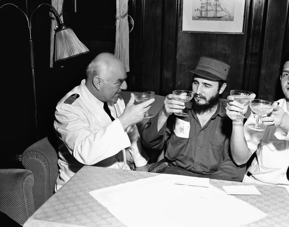 <p>Captain Heinrich Lorenz, left, of cruise ship MS Berlin, proposes a toast to the success of Fidel Castro's government in Cuba, April 15, 1954, Havana, Cuba. Castro visited the North German Lloyd ship after it landed in Havana from New York. (AP Photo) </p>