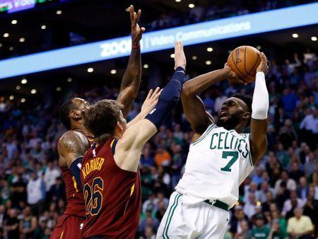 May 15, 2018; Boston, MA, USA; Boston Celtics guard Jaylen Brown (7) attempts a shot against Cleveland Cavaliers forward LeBron James (23) and guard Kyle Korver (26) during the fourth quarter of game two of the Eastern conference finals of the 2018 NBA Playoffs at TD Garden. Mandatory Credit: Greg M. Cooper-USA TODAY Sports