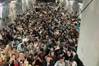 Afghan nationals fleeing Kabul are seen crammed aboard a US Air Force C-17 Globemaster plane taking them to Qatar