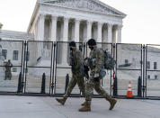 """National Guard troops keep watch at the Supreme Court on Capitol Hill in Washington, early Thursday, March 4, 2021, amid intelligence warnings that there is a """"possible plot"""" by a group of militia extremists to take control of the Capitol on March 4 to remove Democrats from power. The threat comes nearly two months after thousands of supporters of then-President Donald Trump stormed the Capitol in a violent insurrection as Congress was voting to certify Joe Biden's electoral win. (AP Photo/J. Scott Applewhite)"""