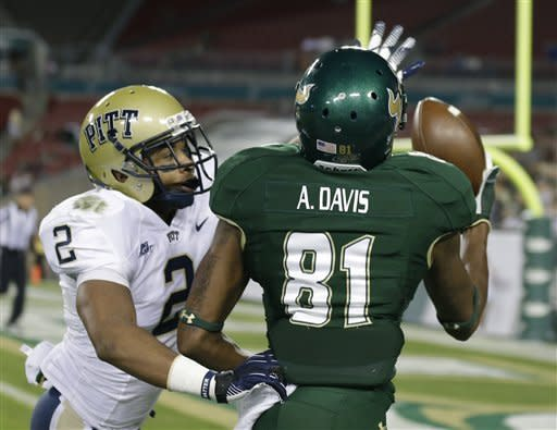 South Florida wide receiver Andre Davis (81) catches a pass in front of Pittsburgh defensive back K'Waun Williams (2) during the first half of an NCAA college football game Saturday, Dec. 1, 2012, in Tampa, Fla. Officials ruled that Davis was out of bounds. (AP Photo/Chris O'Meara)