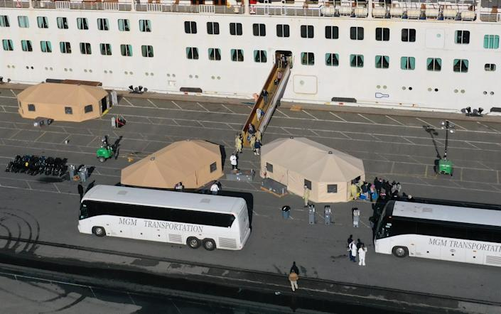 Passengers are evacuated from the Grand Princess cruise ship March 10 in Oakland, Calif.