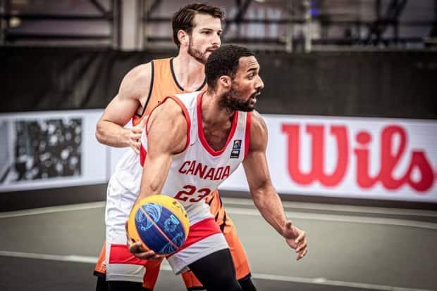 Jordan Jensen-Whyte, shown in this photo from Canada's win over the Netherlands on Friday, and his teammates failed to advance to Sunday's quarter-finals at the men's 3x3 basketball Olympic qualifier following a pair of losses on Saturday. (International Basketball Federation - image credit)