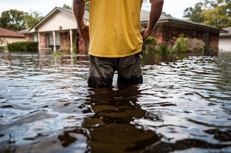 "Oden ""Odie"" Walder walks up to his flooded home in Angleton, Texas, on Monday. (Joseph Rushmore for HuffPost)"