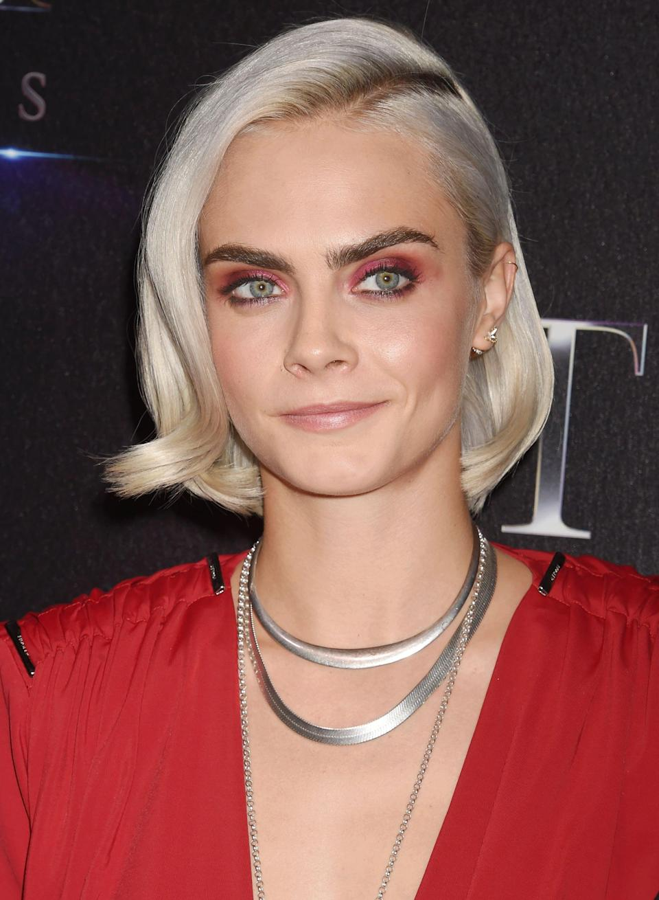 <p>Old Hollywood waves - but make it extremely cool. At CinemaCon, Delevingne wore her lob with a deep, diagonal side part, adding soft bends at the front of the hair à la Veronica Lake in the '40s. The cool, platinum tone and short length breathed new life into the classic red carpet style. </p>
