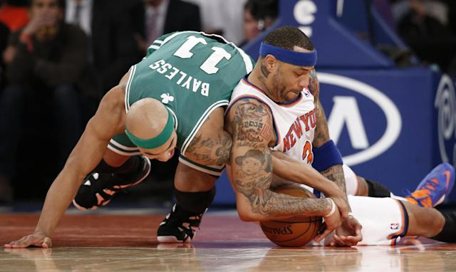 Boston Celtics guard Jerryd Bayless (11) and New York Knicks forward Kenyon Martin (3) battle for a loose ball in the first half of an NBA basketball game at Madison Square Garden in New York, Tuesday, Jan. 28, 2014. (AP Photo/Kathy Willens)