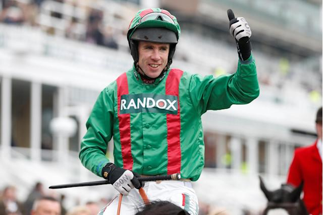 Horse Racing - Grand National Festival - Aintree Racecourse, Liverpool, Britain - April 12, 2018 Derek O'Connor celebrates on Balnaslow after winning the 16:05 Randox Health Foxhunters' Open Hunters' Chase Action Images via Reuters/Matthew Childs
