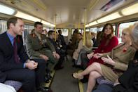 Britain's Prince William (L) and his wife Catherine, Duchess of Cambridge (2nd R), ride with television personalities Barbara Windsor (R) and Alastair Stewart on a 1960's Routemaster bus during a Royal British Legion Poppy Day event in London November 7, 2013. REUTERS/Carl Court/Pool (BRITAIN - Tags: ENTERTAINMENT ROYALS SOCIETY)