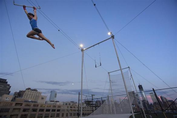 Katrina Cohen practices on a trapeze at Trapeze School New York July 1, 2012.