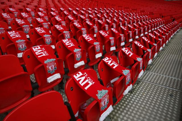 Ninety-six Liverpool scarves are placed on seats on the 25th anniversary of the Hillsborough disaster before the FA Cup semi-final soccer match between Arsenal and Wigan Athletic at Wembley Stadium in London April 12, 2014. Every senior match in England will kick-off seven minutes later than normal this weekend as soccer marks the 25th anniversary of the Hillsborough disaster, when 96 Liverpool fans died at an FA Cup semi-final against Nottingham Forest. REUTERS/Eddie Keogh (BRITAIN - Tags: ANNIVERSARY DISASTER SPORT SOCCER TPX IMAGES OF THE DAY)