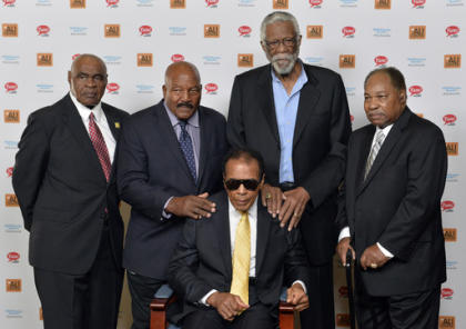 John Wooten, Jim Brown, Bill Russell, and Bobby Mitchell stand behind Muhammad Ali. They all reunited in 2014. (AP)