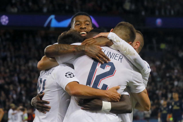 PSG players celebrate after Thomas Meunier scored their third goal during the Champions League group A soccer match between PSG and Real Madrid at the Parc des Princes stadium in Paris, Wednesday, Sept. 18, 2019. (AP Photo/Michel Euler)