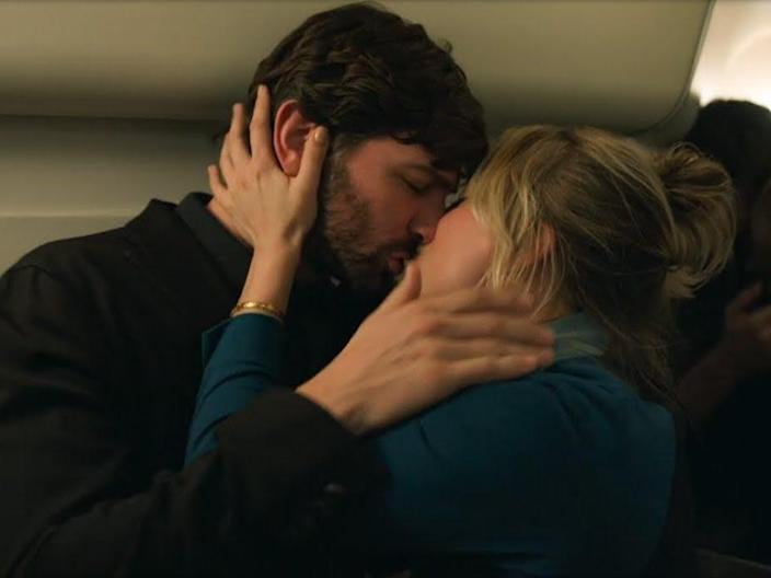 """Alex (Michiel Huisman) and Cassie (Kaley Cuoco) share a passionate kiss inside an airplane bathroom in this still from """"The Flight Attendant."""""""