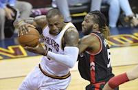 May 25, 2016; Cleveland, OH, USA; Cleveland Cavaliers forward LeBron James (23) drives against Toronto Raptors forward DeMarre Carroll (5) in the second quarter in game five of the Eastern conference finals of the NBA Playoffs at Quicken Loans Arena. Mandatory Credit: David Richard-USA TODAY Sports