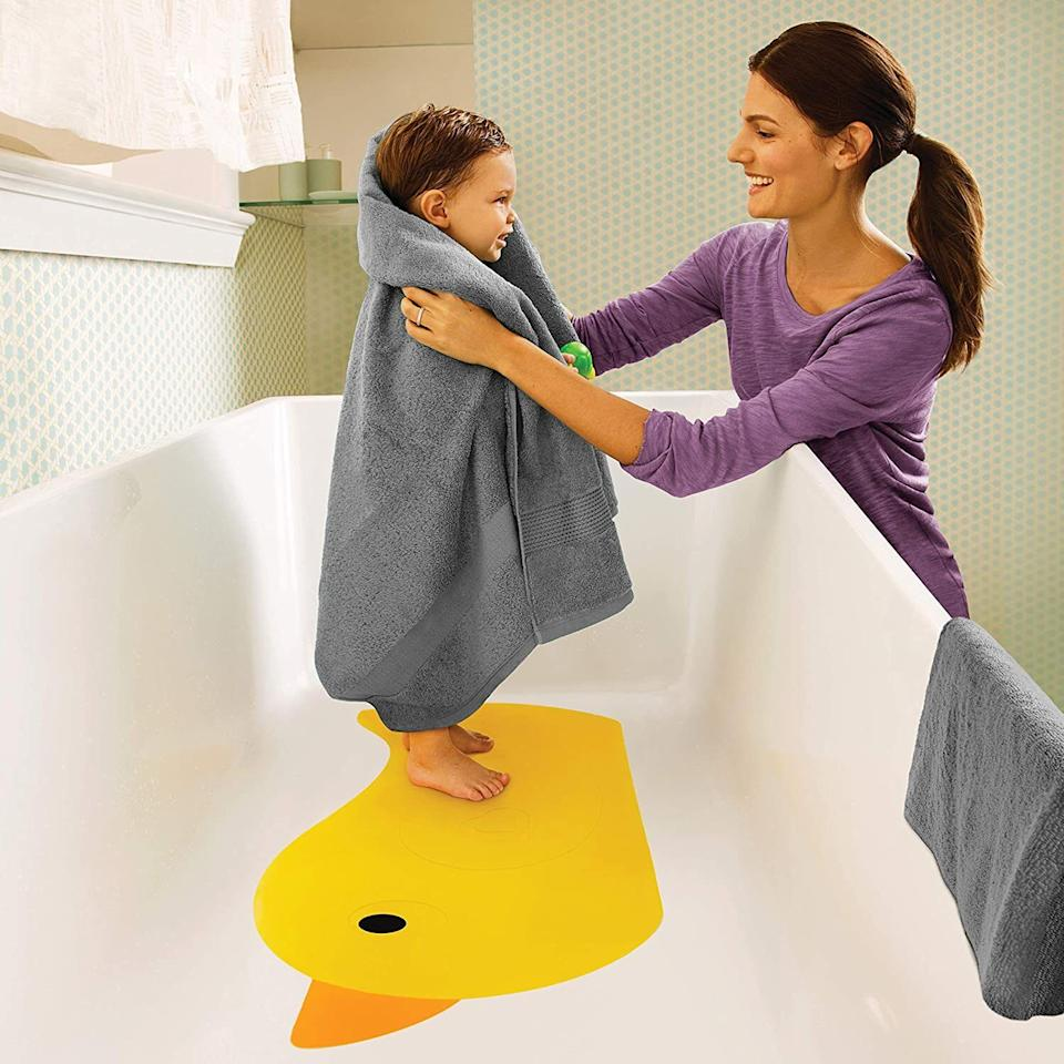 """It's so adorable and will prevent slipping when your little one is stepping in and out of the bathtub.<br /><br /><strong>Promising review:</strong>""""This is the cutest bath mat.<strong> It helps keep my daughter from sliding around during bath time to reduce the risk of slipping or falling over.</strong> She loves the bright color and cute shape. It suctions well and is very easy to clean."""" —<a href=""""https://amzn.to/3op5zJe"""" target=""""_blank"""" rel=""""noopener noreferrer"""">Laura</a><br /><br /><a href=""""https://amzn.to/2S5LjQA"""" target=""""_blank"""" rel=""""noopener noreferrer""""><strong>Get it from Amazon for$12.64.</strong></a>"""