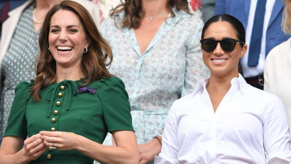 Kate Middleton and Meghan Markle enjoy a match at Wimbledon last year. (Image via Getty Images)