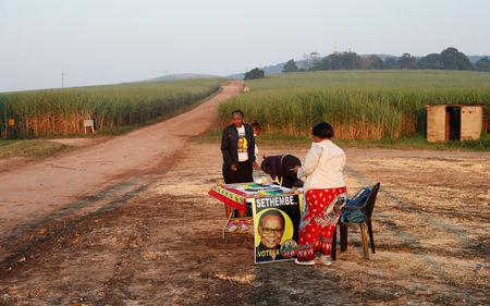 Inkatha Freedom Party agents are seen near a polling station ahead of South AfricaÕs parliamentary and provincial elections in the Farm lands near Eshowe, South Africa May 8, 2019. REUTERS/Rogan Ward