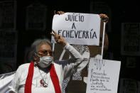 """Ana """"La Nacha"""" Ignacia Rodríguez, a member of the 1968-71 student movement, takes part in a demonstration outside the residence of former Mexican President Luis Echeverría, (1970-1976), during a march to commemorate the 50th anniversary of the student massacre of 1971 known as """"El Halconazo,"""" in Mexico City, Thursday, June 10, 2021. The attack, also known as the Corpus Christi massacre, was carried out by a group of men apparently recruited by the government to dissolve a pro-democracy student demonstration. (AP Photo/Marco Ugarte)"""