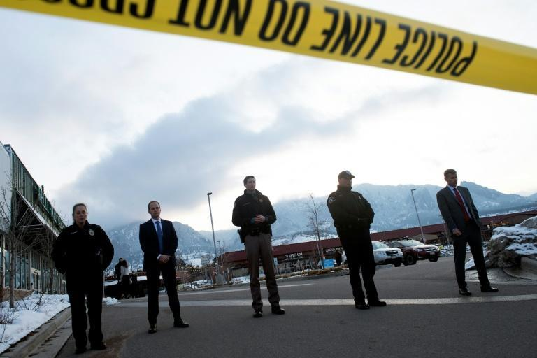 The shooter is being held in custody and was injured, officials said
