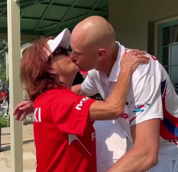 A photo of Lynne McGranger and Ryan 'Fitzy' Fitzgerald kissing at a charity cricket match.