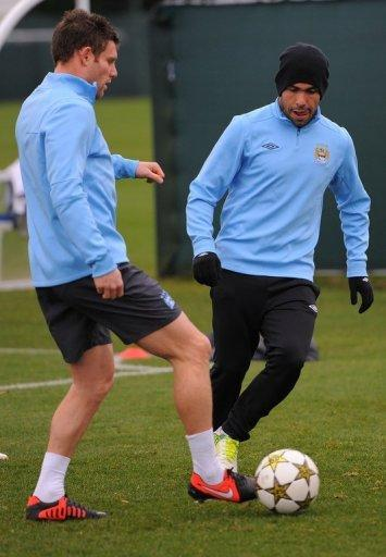 """Manchester City's James Milner (L) and Carlos Tevez during a team training session on November 20. """"We need to take our chances. We had a number of corners (against Chelsea) and chances that didn't go our way,"""" Milner said"""