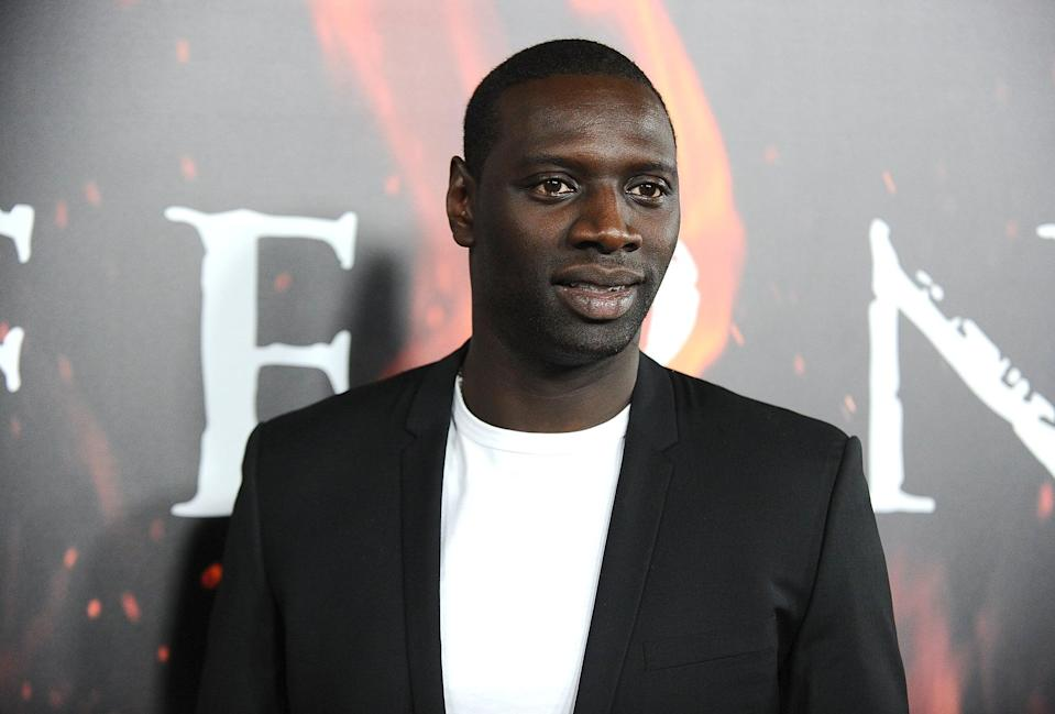 "<p>Omar's life changed after he starred in <strong>The Intouchables</strong>, especially after the movie became a huge hit in the US. Suddenly, English-language roles became available to him . . . which meant <a href=""http://lrmonline.com/news/interview-with-night-shift-actor-omar-sy/"" class=""link rapid-noclick-resp"" rel=""nofollow noopener"" target=""_blank"" data-ylk=""slk:he had to learn English"">he had to learn English</a>. As he explained to LRM Online in April 2020, ""Everything changed because I had more choices in movies, or movies in English. I had to learn English. I changed the place I live. I was living in Paris. I now live in Los Angeles."" </p> <p>The role didn't just change the roles available to Omar. Suddenly, he found himself with far more attention. ""My way to see the work changed, too, because the projects are different and I have more choices. So I had to pick different things,"" he continued. ""I had more mics in my face . . . you know people are listening, so you have to be careful. That's a good awareness, because in the beginning I was talking just like that. I was just a young guy, happy to be here, but when you are happy you say things and then you see the consequences. So you start to think, okay, when I say that, that's what they hear. That's what they do with that.""</p>"