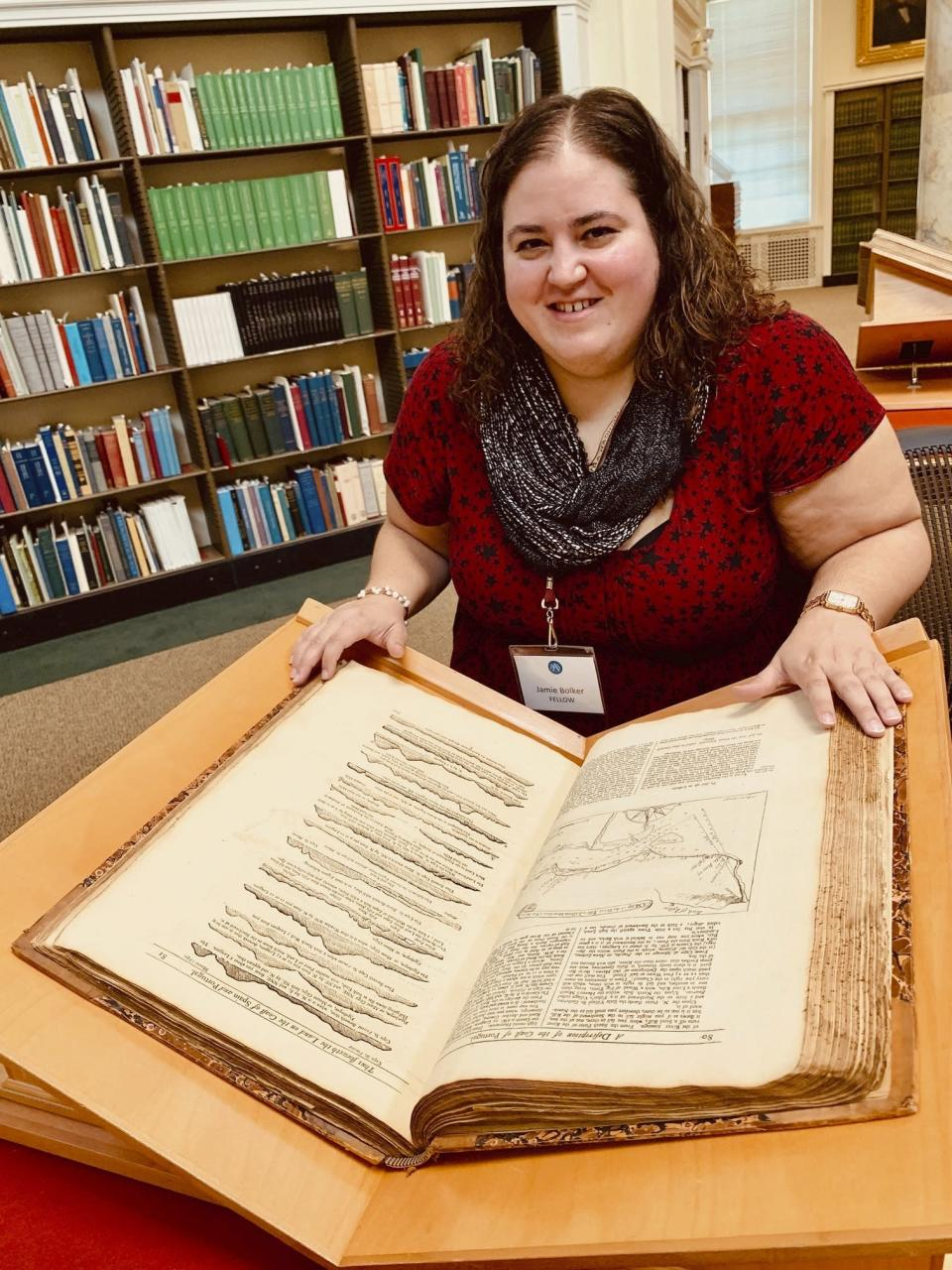 "This May 2019 photo provided by Ben Bascom shows Jamie Bolker while doing research at the American Antiquarian Society in Worcester, Mass. When Bolker started teaching composition at MacMurray College in January 2020, she felt like she'd won the lottery. In March, though, she delivered a grim Twitter announcement: ""Welp. MacMurray College is permanently closing ... They were already on the edge and coronavirus was the final nail."" (Ben Bascom via AP)"