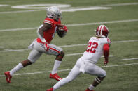 Ohio State running back Trey Sermon, left, cuts up field against Indiana defensive back Jamar Johnson during the first half of an NCAA college football game Saturday, Nov. 21, 2020, in Columbus, Ohio. (AP Photo/Jay LaPrete)