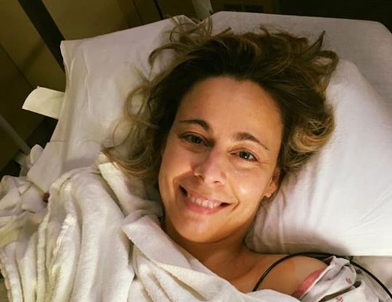 Kristie Holmes in bed after suffering a heart attack.