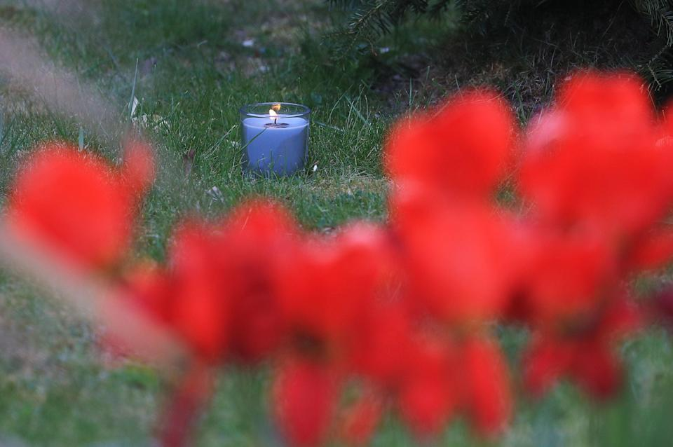 A lit candle marks one week since the death of PCSO Julia James, at her family home in SnowdownPA
