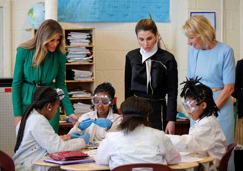 From left, First lady Melania Trump, Queen Rania of Jordan, and Education Secretary Betsy DeVos talk with students during a science class at the Excel Academy Public Charter school in Washington, Wednesday, April 5, 2017 - Credit: AP