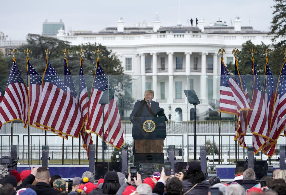 FILE - In this Jan. 6, 2021, file photo with the White House in the background, President Donald Trump speaks at a rally in Washington. The Biden administration will have a big say in whether the government releases information to Congress on the actions of former president Donald Trump and his aides on Jan. 6. But there could be a lengthy court battle before any details come out. (AP Photo/Jacquelyn Martin, File)