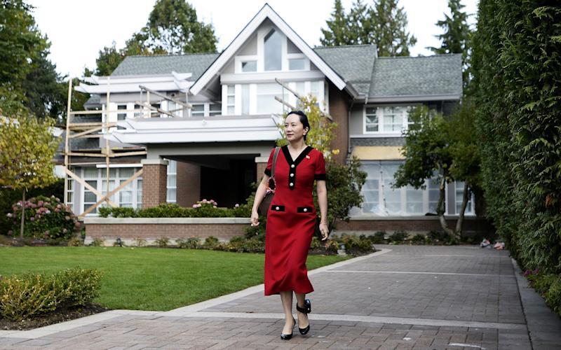 Meng Wanzhou, chief financial officer of Huawei, leaves her home for a court appearance wearing an electronic ankle tag  - Bloomberg