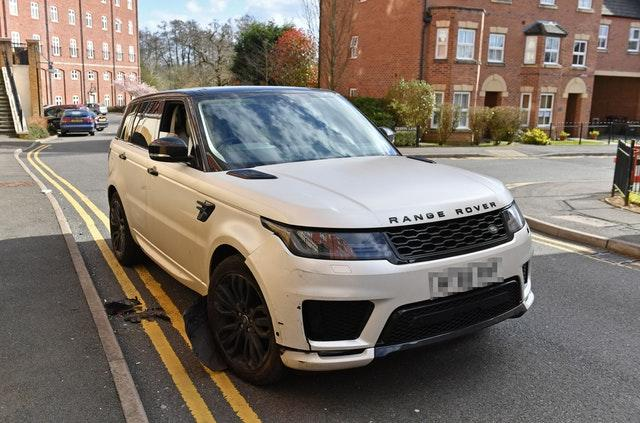 A damaged white Range Rover after reports of a crash with parked cars in the Dickens Heath area of Solihull