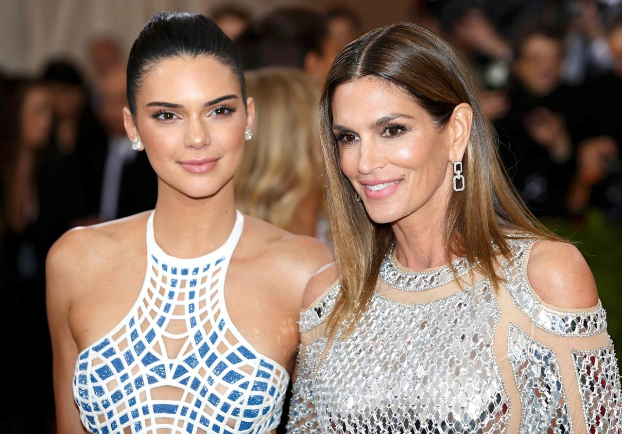 "Television personality Kendall Jenner (L) and model Cindy Crawford arrive at the Metropolitan Museum of Art Costume Institute Gala (Met Gala) to celebrate the opening of ""Manus x Machina: Fashion in an Age of Technology"" in the Manhattan borough of New York, May 2, 2016. REUTERS/Eduardo Munoz TPX IMAGES OF THE DAY"
