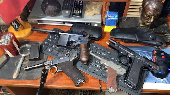 Nazi objects and weapons are seen in a home of an alleged paedophile in Rio de Janeiro