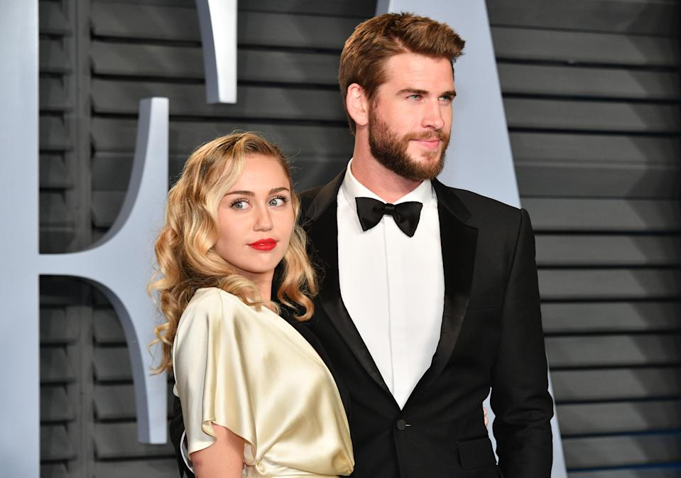 Miley Cyrus and Liam Hemsworth attend the 2018 Vanity Fair Oscar Party on March 4, 2018, in Beverly Hills, Calif. (Photo: Getty Images)