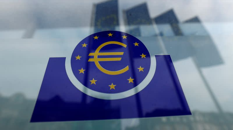 FILE PHOTO: Specialists work on a crane in front of the European Central Bank (ECB) in Frankfurt