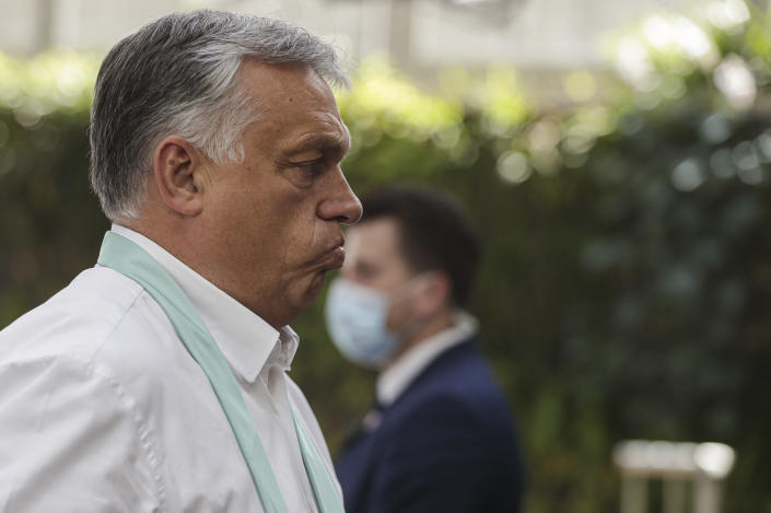 Hungary's Prime Minister Viktor Orban arrives for an EU summit in Brussels, Monday, July 20, 2020. Leaders from 27 European Union nations stretch their meeting into a fourth day on Monday to assess an overall budget and recovery package spread over seven years. (Stephanie Lecocq, Pool Photo via AP)