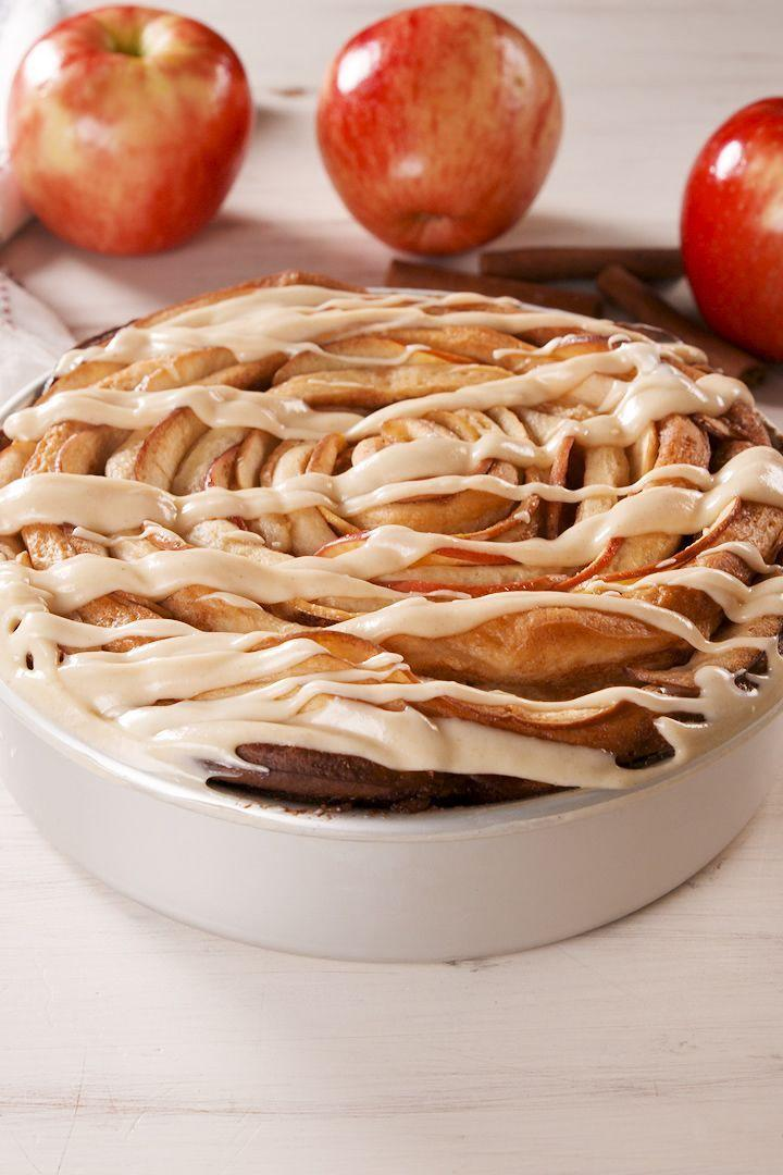 """<p>This giant cinnamon roll is stuffed with thinly sliced apples and drizzled with a caramel cream cheese frosting. In other words: IT'S INSANE. And your friends and family will freak out. It pairs perfectly with <a href=""""https://www.delish.com/uk/cocktails-drinks/a32027975/apple-cider-mimosas-recipe/"""" rel=""""nofollow noopener"""" target=""""_blank"""" data-ylk=""""slk:Apple Cider Mimosas"""" class=""""link rapid-noclick-resp"""">Apple Cider Mimosas</a> 😉</p><p>Get the <a href=""""https://www.delish.com/uk/cooking/recipes/a33120732/giant-caramel-apple-cinnamon-roll-recipe/"""" rel=""""nofollow noopener"""" target=""""_blank"""" data-ylk=""""slk:Giant Caramel Apple Cinnamon Roll"""" class=""""link rapid-noclick-resp"""">Giant Caramel Apple Cinnamon Roll</a> recipe.</p>"""