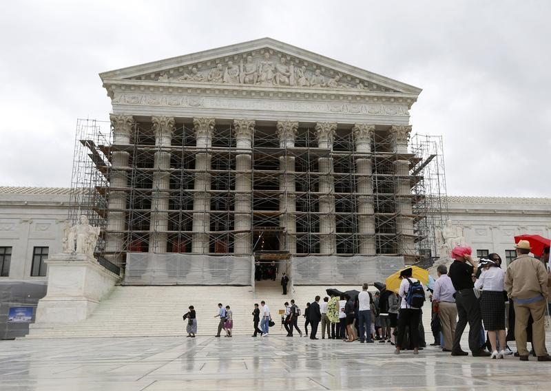 Visitors to the Supreme Court are pictured jn the rain in Washington