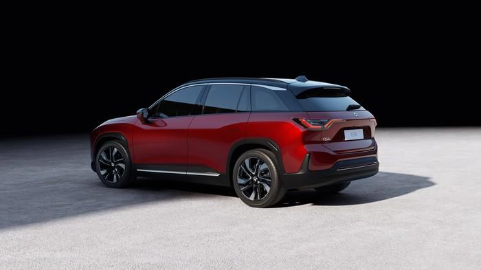 A red NIO ES6, a sleek midsize SUV.