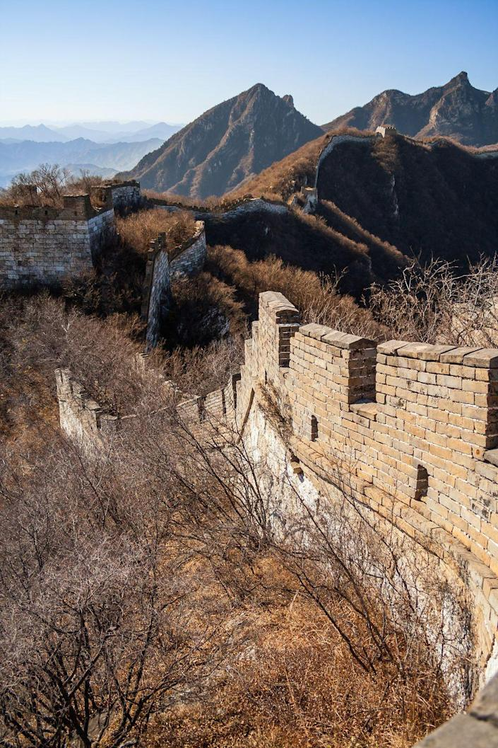 <p>Due to its immense size and cost of upkeep, parts of the Great Wall of China have fallen into disrepair. Wild overgrowths now fill the walkways with thick shrubs, grass, and weeds. </p>