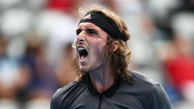 Tsitsipas saunters through in Sydney, Fritz shocks Isner